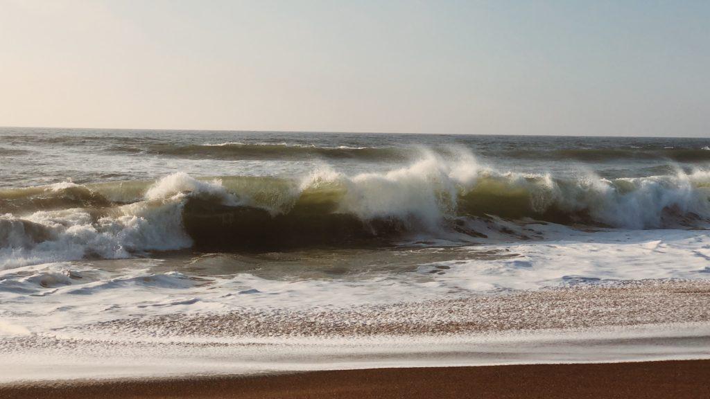 Waves crashing on the beach.